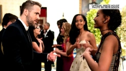 Malia Obama gives Sasha an adorable thumbs-up as she chats with Ryan Reynolds