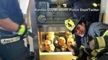 Firemen rescue cops stuck in elevator, take embarrassing photo