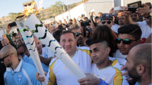 Syrian Refugee Carries Olympic Torch Through Migrant Camp in Athens