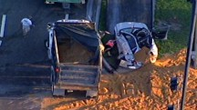 Dump Truck Crash Buries Driver in Sand