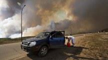 Evacuation: Dashcam Footage Shows Alberta Wildfire at Close Range
