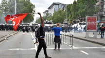 Police, Demonstrators Clash as Anti-Austerity Rally Turns Violent