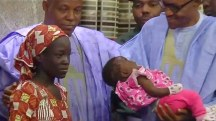 Freed Chibok Schoolgirl and Baby Welcomed by President Buhari