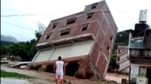 Watch Three-Story Building Topple Into River