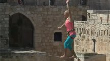 Balancing Act: Woman Walks Slackline Over Jerusalem