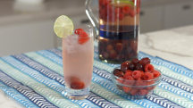 Toast mom with a sparkling raspberry lime sangria