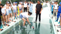 China's New Glass Bridge Gets Smashed With Sledgehammer