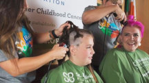 Moms opt for buzz cuts to fight childhood cancer