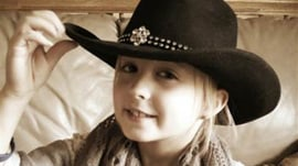 8-year-old girl with breast cancer home for holidays after mastectomy