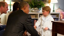 Prince George stays up past his bedtime to greet Obama
