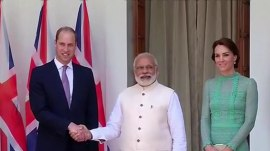 Prince William learns that India's prime minister has a powerful grip