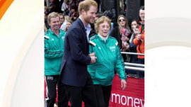 Prince Harry helps former Olympian, 86, after she falls
