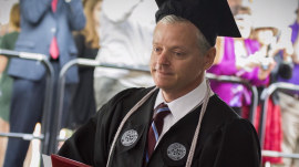 School custodian gets his 'someday' — and his diploma! Watch him graduate