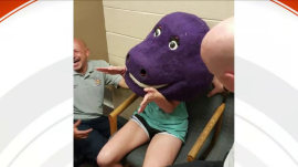 Dino-sorehead: Teen gets her head stuck in Barney costume
