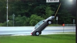 Hold the phone! GPS leaves motorist dangling from telephone pole wire