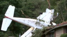Small plane crashes into house, sending pilot, passenger to hospital