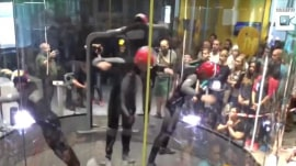 Watch 4 indoor sky divers' amazing routine inside wind tunnel