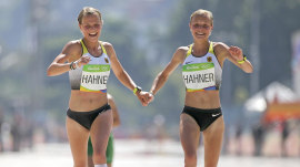 Twin sisters hold hands at end of marathon: Heartwarming, or stunt?