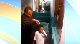 'I'm baptized!' Boy, 6, dunks himself at his own baptism