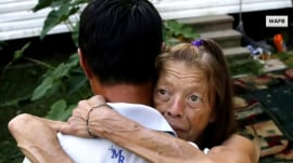 Louisiana woman reunites with hero who saved her and dog from car in flood