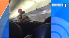 Man soothes passenger's upset toddler to sleep on plane