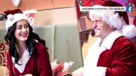 Katy Perry and Orlando Bloom play Santa & Mrs. Claus at LA children's hospital