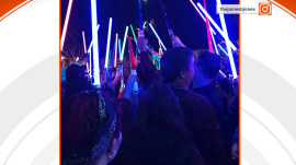 Carrie Fisher fans hold lightsaber vigil at Disneyland
