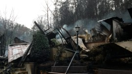 Tennessee wildfires: Death toll climbs, rescues slowed by mud, rockslides