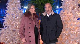Rockefeller Center Christmas tree lights up, but rain pours down on TODAY anchors
