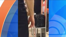 Watch this passenger stomp on his carry-on bag to make it fit