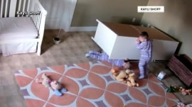 Watch 2-year-old save trapped twin brother from under fallen dresser