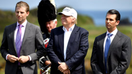 Trump turns his businesses over to his sons, but questions linger