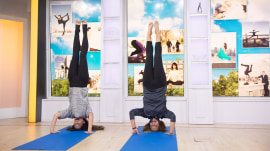 Watch Katie Couric interview Hilaria Baldwin while they both do headstands
