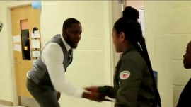 Watch this teacher give personalized handshakes to each of his students