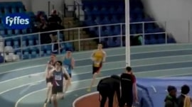 Watch runner get snagged by a rubber band on his way to finish line