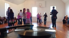 These small-town students sing and dance every morning to learn how to get along