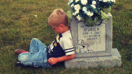 Little boy visits grave to honor identical twin who died in the womb