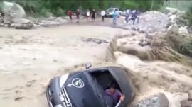Caught on video: Driver's amazing escape from flash flood in Peru