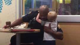 This little boy hugged a police officer and it's the sweetest thing