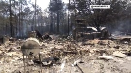 Florida wildfires destroy at least 9 homes as thousands evacuate