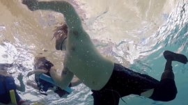 Former Marine swims again with new prosthetic leg