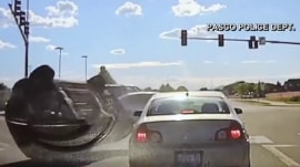 Caught on camera: Officer escapes accident by seconds after car flips at an intersection