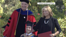 Mom who went to classes with quadriplegic son gets honorary MBA