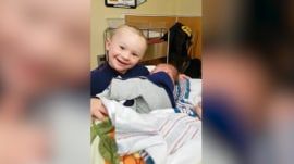 Watch this little boy greet his newborn brother with absolute glee