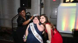 Prom queen gives crown to girl with Down syndrome