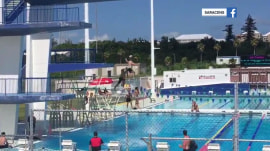 Watch rugby players pass the ball across 10 diving boards