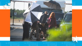 Taylor Swift uses 3 umbrellas to hide from paparazzi