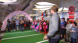 Carolina Panthers player Greg Olsen tackles cancer with football passes
