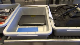 Government urges airlines to ban laptops in checked bags, citing fire risk