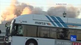 Bus blocks dramatic shot of Georgia Dome being demolished